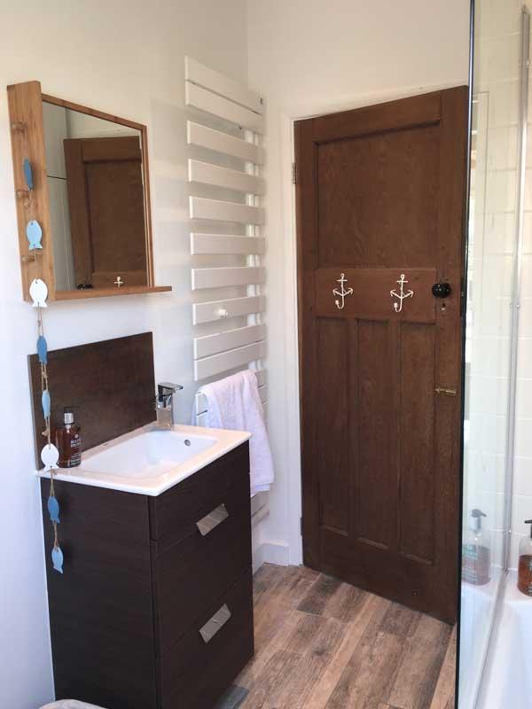 modern bathroom with heated floor and towel rail